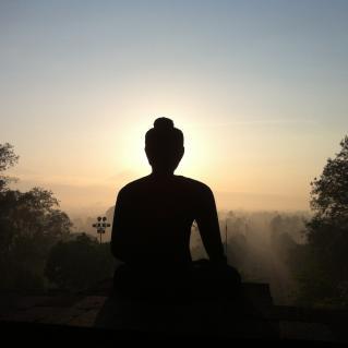 the sunrise at the top level of Borobudur temple